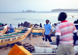 In the early evenings, people gather at key spots on the beach in Dakar to buy fish straight off the small, colorful fishing boats.